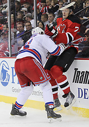 Nov 5, 2010; Newark, NJ, USA;  New York Rangers left wing Alexander Frolov (31) hits New Jersey Devils defenseman Henrik Tallinder (7) during the second period at the Prudential Center.