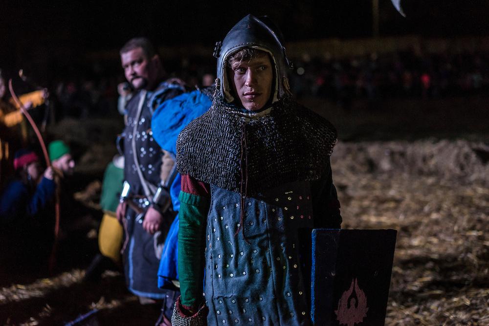 Men dressed in armor demonstrate the storming of a castle during a medieval festival on Saturday, September 24, 2016 in Mstislavl, Belarus.