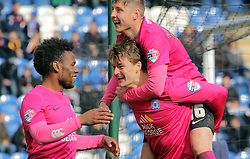 Andrew Fox (bottom) of Peterborough United celebrates scoring his sides second goal of the game with team-mates Shaquile Coulthirst (left) and Harry Beautyman (top) - Mandatory by-line: Joe Dent/JMP - 16/04/2016 - FOOTBALL - Weston Homes Community Stadium - Colchester, England - Colchester United v Peterborough United - Sky Bet League One