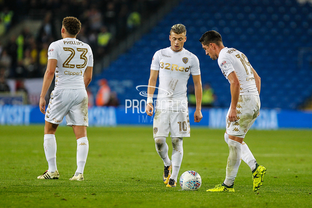 Ezgjan Alioski of Leeds United and Pablo Hernandez of Leeds United stand over a free kick during the EFL Sky Bet Championship match between Cardiff City and Leeds United at the Cardiff City Stadium, Cardiff, Wales on 26 September 2017. Photo by Andrew Lewis.