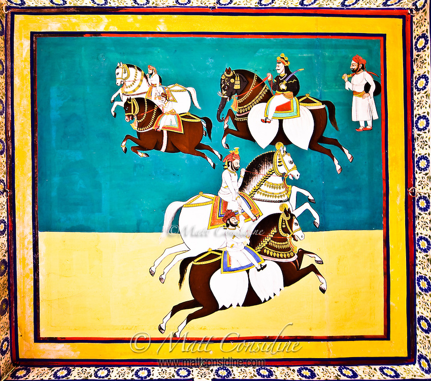 Decorative mural in vivid colors showing horse riders carrying swords.<br /> (Photo by Matt Considine - Images of Asia Collection)