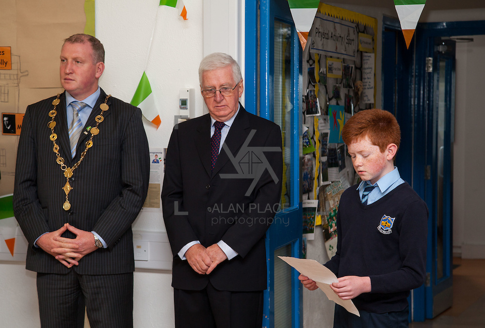 23/10/2015       <br /> Members of the Defence Forces were in Abbeyfeale today to present a handmade Tricolour and a copy of the Proclamation of the Irish Republic to students of the town's two primary schools.<br /> <br /> St Marys Boys National School and Scoil Mh&aacute;thair D&eacute; are among 3,000 schools nationally and 152 Limerick primary schools to receive the presentation as part of initiatives to mark the centenary of the 1916 Rising.&nbsp;<br /> <br /> Councillor Liam Galvin, Mayor of the City and County of Limerick joined pupils and teachers for today's presentation ceremony, which saw representatives of the Defences Forces raise the flag and read the Proclamation. <br /> <br />  Picture: Alan Place.
