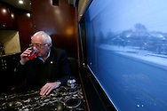 Democratic presidential candidate Bernie Sanders takes a moment to sip some red Powerade between an on-bus interview  and a stop at a campaign office to greet staff and volunteers Tuesday, Jan 26, 2016 in Des Moines.