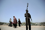 """Refugees arriving from the Afgoye corridor into the city after fighting erupted between al- Shabaab abd goverment forces.Death or Play. Women´s Basketball in Mogadishu<br /> Women's basketball? In Europa and the U.S., we take it for granted. But consider this: In Mogadishu, war-torn capital of Somalia, young women risk their lives every time they show up to play.<br /> Suweys, the captain of the Somali women´s basketball team, and her friends play the sport of the deadly enemy, called America. This is why they are on the hit list of the killer commandos of Al Shabaab, a militant islamist group, that has recently formed an alliance with the terrorist group Al Qaeda and control large swathes of Somalia.<br /> <br /> Al Shabaab, who sets bombs under market stands, blows up cinemas, and stones women, has declared the female basketball players """"un-islamic"""". One of the proposed punishments is to saw off their right hands and left feet. Or simply: shoot them.<br /> <br /> Suweys´ team trains behind bullet-ridden walls, in the ruins of the failed city of Mogadishu – protected by heavily armed gun-men. The women live in constant fear of the islamist killer commandos. Stop playing basketball? Never, they say.<br /> Women´s basketball in the world´s most dangerous capital. Female basketball in Mogadishu, Somalia.<br /> A deadly game.."""