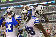 DALLAS, TX - SEPTEMBER 23:  Dez Bryant #88, Dwayne Harris #17 and LeQuan Lewis #23 of the Dallas Cowboys celebrate after a touchdown against the Tampa Bay Buccaneers at Cowboys Stadium on September 23, 2012 in Dallas, Texas.  The Cowboys defeated the Buccaneers 16-10.  (Photo by Wesley Hitt/Getty Images) *** Local Caption *** Dez Bryant; Dwayne Harris; LeQuan Lewis