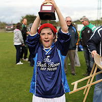 Rachel Sheedy Newmarket-on-Fergus U13 Girls Captain raises aloft the U13 Cup.<br /> Photograph by Flann Howard