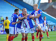 Kyle Dempsey of Carlisle United (centre, number 22) celebrates scoring from a header his team's first goal during the Sky Bet League 2 match at Brunton Park, Carlisle<br /> Picture by Greg Kwasnik/Focus Images Ltd +44 7902 021456<br /> 06/09/2014