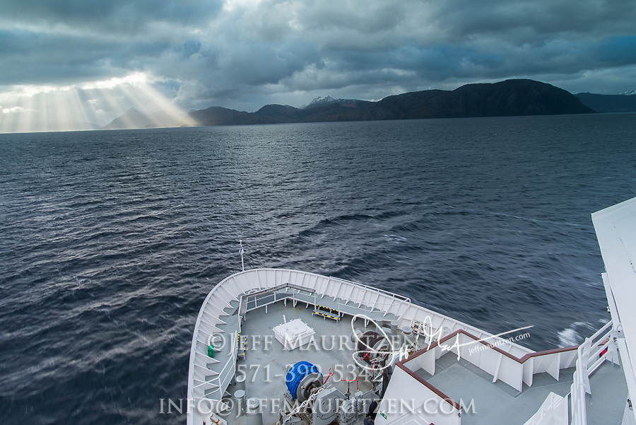 The bow of the National Geographic Explorer expedition ship travels through the Beagle Channel, Tierra del Fuego.