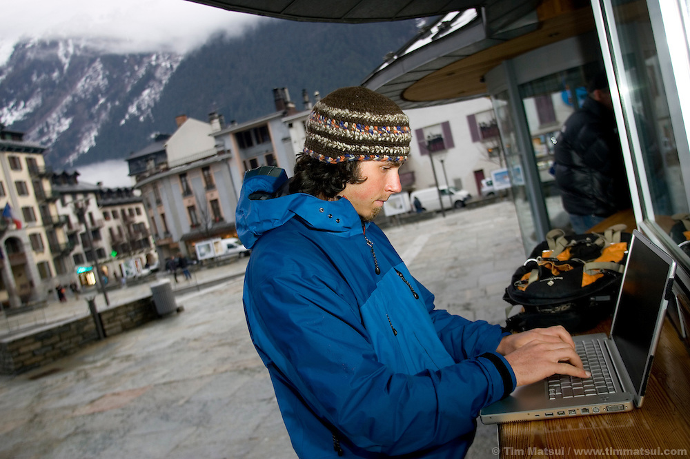 A tourist uses the wi-fi outside the Office of Tourism, Chamonix, France.