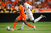 Edson Braafheid (NED) and Emile Heskey (ENG) compete for the ball during the International Friendly between Netherlands and England at the Amsterdam Arena on August 12, 2009 in Amsterdam, Netherlands.