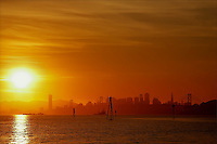 Sun setting over San Francisco on cold, late winter afternoon.  Copyright 2007 Reid McNally.