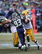 Seattle Seahawks defensive end O'Brien Schofield (93) gets blocked by Green Bay Packers guard T.J. Lang (70) as he rushes during the NFL week 20 NFC Championship football game against the Green Bay Packers on Sunday, Jan. 18, 2015 in Seattle. The Seahawks won the game 28-22 in overtime. ©Paul Anthony Spinelli