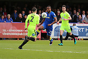 AFC Wimbledon striker Tyrone Barnett (23) taking on Peterborough United defender Michael Smith (2) during the EFL Sky Bet League 1 match between AFC Wimbledon and Peterborough United at the Cherry Red Records Stadium, Kingston, England on 17 April 2017. Photo by Matthew Redman.
