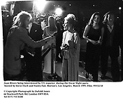 Joan Rivers being interviewed by T.V. reporter  during the Oscar Night party hosted by Steve Tisch and Vanity Fair. Morton's. Los Angeles. March 1995. Film. 95532/18<br />