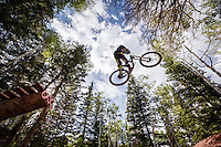 Mike Montgomery jumping his downhill mountain bike at Canyons Resort.