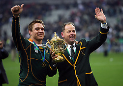 South Africa captain John Smit and coach Jake White celebrate with The Webb Ellis Trophy