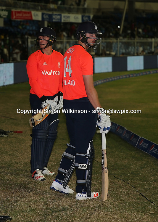 PICTURE BY MARK GREEN/SWPIX.COM  Pakistan v England 1st T20, Sharjah Cricket Stadium, UAE, 30/11/15 <br /> England players, Eoin Morgn &amp; James Vince prepare to go out for the super over