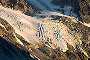 Hanging glaciers glowing in evening light, Coast Mountains British Columbia Canada