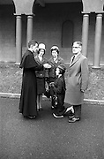 14/03/1964<br /> 03/14/1964<br /> 14 March 1964<br /> Ordination of Fr. Donal Sullivan at Holy Cross College (Clonliffe College), Clonliffe Road, Drumcondra, Dublin. Picture shows Fr. Donal Sullivan, C.M., Kenilworth, Ballinacurra, Co. Limerick, giving his blessing to his sister Winifred. Also in image are his sister Mary, and Mr and Mrs P. Sullivan.