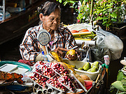 27 SEPTEMBER 2016 - BANGKOK, THAILAND:  A vendor sells mango and sticky rice, a popular Thai snack, at the floating market in Damnoen Saduak, Thailand. The market is famous because vendors cruise the canals around the market selling produce and tourist curios. It is one of the best known tourist attractions in Samut Songkhram province.     PHOTO BY JACK KURTZ