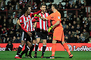 Burton Albion goalkeeper Stephen Bywater (1) argues with Brentford midfielder Romaine Sawyers (19) and Brentford defender Andreas Bjelland (5) during the EFL Sky Bet Championship match between Brentford and Burton Albion at Griffin Park, London, England on 21 November 2017. Photo by Richard Holmes.