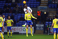 Matthew Mills of Bolton Wanderers jumps above Grant Holt of Huddersfield Town . Skybet football league championship match, Bolton Wanderers v Huddersfield Town at the Macron stadium in Bolton, Lancs on Saturday 29th November 2014.<br /> pic by Chris Stading, Andrew Orchard sports photography.