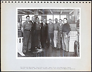 page from a photo album with returned to work soldier portraits USA 1946