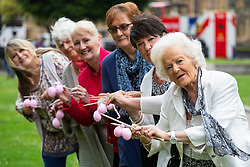 Edna Cosnett, 93, right, from New Malden is joined outside parliament by 'knitting nans' from across the UK supporting Fathers4Justice. The grandmothers are knitting 650 pairs of balls, enough for every MP, to campaign for separated fathers to have greater access to their children. Edna has not seen her great grandchild for two years. Susan Stamper, 69, also pictured has not seen her grandchild in 20 years London, June 04 2018.