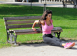 (EXCLUSIVE PICTURES) Chloe Khan aka Chloe Mafia, enjoys a morning workout with her personal trainer at a park in Cheshire. The XFactor reject who now enjoys an millionaire lifestyle in LA, is owner of an adult webcam business and employs 50 staff. UK. 20/10/2015<br />