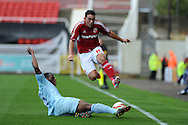 Swindon's Gary Roberts © is tackled by Coventry's Nathan Cameron. NPower league one, Swindon Town v Coventry city at the County Ground in Swindon on Saturday 13th October 2012.  pic by  Andrew Orchard, Andrew Orchard sports photography,