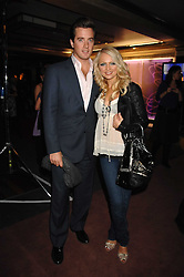 HANNAH SANDLING and OLIVER FELSTEAD at a party to celebrate the launch of the new purple Sony Ericsson K770i phone held at the Bloomsbury Ballroom, Bloomsbury Square, London on 24th October 2007.<br />