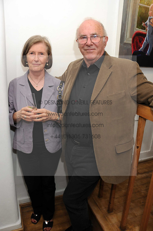 CLIVE JAMES and his wife PRU at a private view of paintings by Laura Smith at 54 The Gallery, Shepherd Market, London W1 on 8th July 2008.<br />