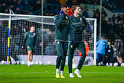 Leeds United defender Ben White (5) and Leeds United forward Patrick Bamford (9) warming up during the EFL Sky Bet Championship match between Leeds United and Hull City at Elland Road, Leeds, England on 10 December 2019.