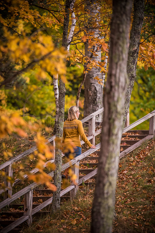 A walk beneath a fall color canopy at Presque Isle Park in Marquette, Michigan.