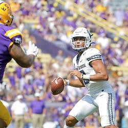 Oct 5, 2019; Baton Rouge, LA, USA; Utah State Aggies quarterback Jordan Love (10) looks to pass against the LSU Tigers during the first quarter at Tiger Stadium. Mandatory Credit: Derick E. Hingle-USA TODAY Sports