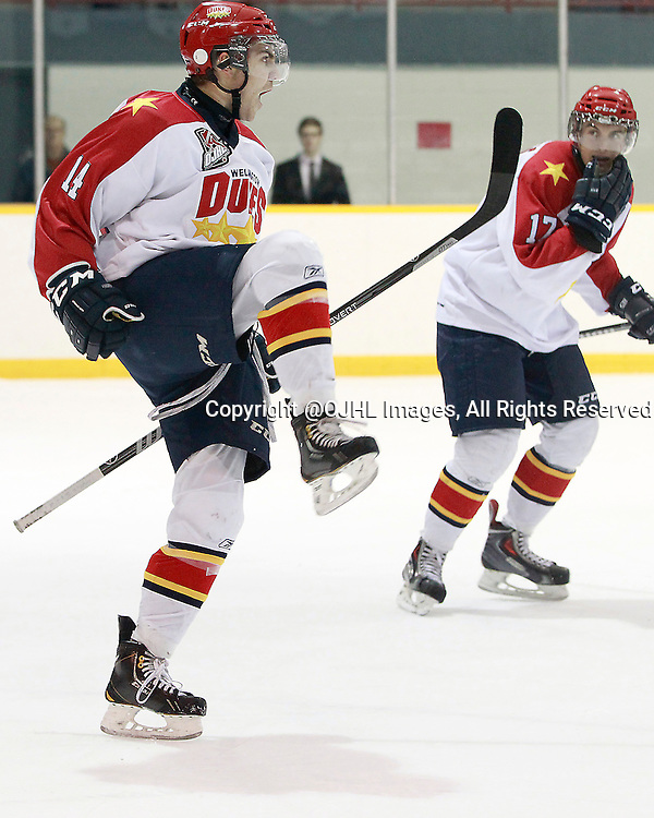 LINDSAY, ON - Oct 24, 2014 : Ontario Junior Hockey League game action between Wellington and Lindsay. Marco Azzano #14 of the Wellington Dukes celebrates the goal during the first period.<br /> (Photo by Tim Bates / OJHL Images)