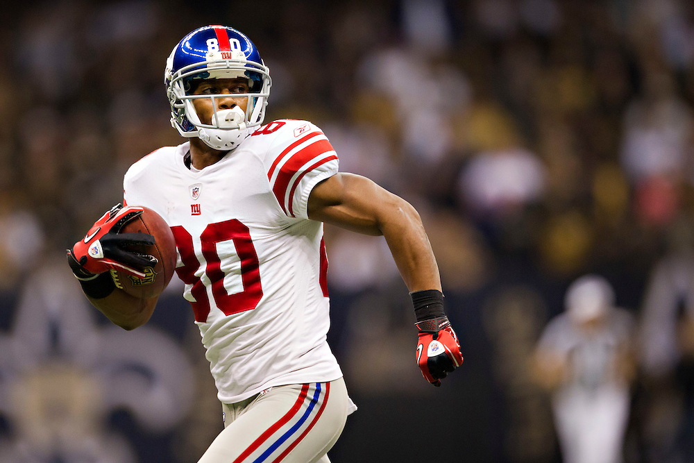NEW ORLEANS, LA - NOVEMBER 28:   Victor Cruz #80 of the New York Giants runs a pass for a touchdown against the New Orleans Saints at Mercedes-Benz Superdome on November 28, 2011 in New Orleans, Louisiana.  The Saints defeated the Giants 49-24.  (Photo by Wesley Hitt/Getty Images) *** Local Caption *** Victor Cruz