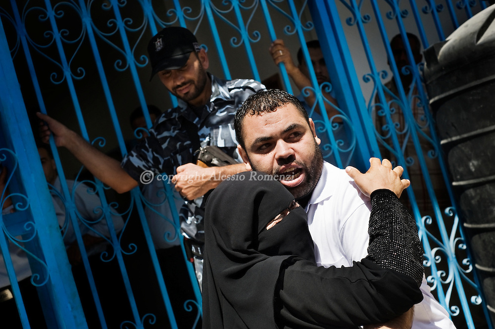 Palestinian woman embrace a just realesed prisoners in front  of Hamas-run prison in Gaza City on September 8, 2010 after the Islamic movement leader in Gaza Strip Ismail Haniyeh ordered an amnesty before the Islamic festivity of Eid al-Fitr which marks the end of the Muslim month of Ramadan.© ALESSIO ROMENZI