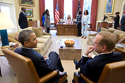 President Barack Obama talks with Jim Clark, President and CEO, Boys & Girls Clubs of America, while young women representing the organization check out the Resolute Desk in the Oval Office, March 16, 2015. (Official White House Photo by Pete Souza)<br /> <br /> This official White House photograph is being made available only for publication by news organizations and/or for personal use printing by the subject(s) of the photograph. The photograph may not be manipulated in any way and may not be used in commercial or political materials, advertisements, emails, products, promotions that in any way suggests approval or endorsement of the President, the First Family, or the White House.