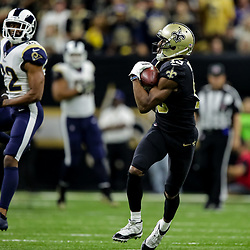 Nov 4, 2018; New Orleans, LA, USA; New Orleans Saints wide receiver Michael Thomas (13) catches a touchdown over Los Angeles Rams cornerback Troy Hill (32) during the fourth quarter at the Mercedes-Benz Superdome. Mandatory Credit: Derick E. Hingle-USA TODAY Sports