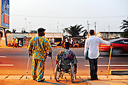11-11-20  -- LOME, TOGO  --  Three men with disabilities attempt to cross Togo's main coastal highway in Lomé on Nobember 20. In November 2011, Togo adopted the World Report on Disability (WRD) -- a joint effort of the World Health Organization (WHO) and the World Bank.   Photo by Daniel Hayduk