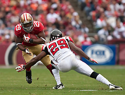 October 11, 2009; San Francisco, CA, USA;  San Francisco 49ers running back Glen Coffee (29) is tackled by Atlanta Falcons cornerback Brian Williams (29) in the first quarter at Candlestick Park. Atlanta won 45-10.