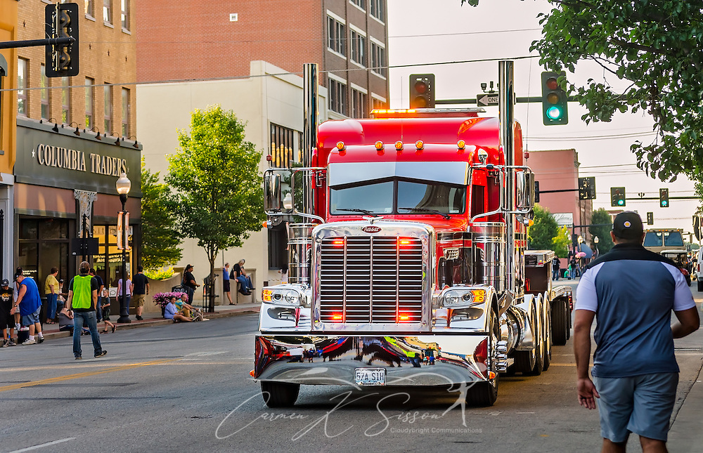 A Peterbilt truck drives down Main Street during the 34th annual Shell Rotella SuperRigs parade, June 10, 2016, in Joplin, Missouri. SuperRigs, organized by Shell Oil Company, is an annual beauty contest for working trucks. Approximately 89 trucks entered this year's competition. (Photo by Carmen K. Sisson/Cloudybright)