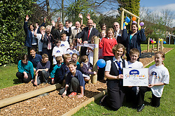 John Heeley with  Thrybergh Fullerton Church of England Primary School  Staff, Governors, Trustees and school council with representatives from Trinty Croft school watch as  Royal Bank of Scotland representative Amanda Burgin presents Ryan Wood, and Terri Bailey with RBS Supergrounds certificate.26 April 2010. Images © Paul David Drabble.