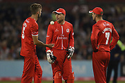Lancashires Toby Lester & Lancashires Liam Livingstone (Capt) & Lancashires Jos Buttler (Wicket Keeper) discuss the final ball during the Vitality T20 Blast North Group match between Lancashire County Cricket Club and Yorkshire County Cricket Club at the Emirates, Old Trafford, Manchester, United Kingdom on 20 July 2018. Picture by George Franks.