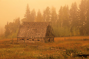 old barn in morning fog<br /> near Golden <br /> British Columbia<br /> Canada