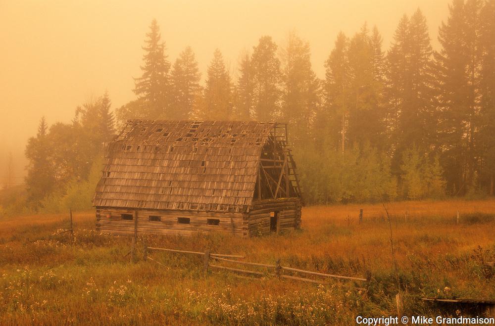 old barn in morning fog<br /> near Golden <br /> British Columbia<br /> Canada