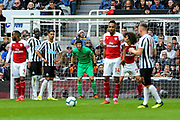 Petr Cech (#1) of Arsenal watches the ball as Matt Ritchie (#11) of Newcastle United lines up to deliver a free kick during the Premier League match between Newcastle United and Arsenal at St. James's Park, Newcastle, England on 15 September 2018.