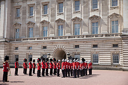 © Licensed to London News Pictures. 26/06/2017. London, UK. The 2nd Battalion, Princess Patricia's Canadian Light Infantry (R) becomes the Queen's Guard at Buckingham Palace. The Canadian Light Infantry are taking part in the Changing of the Guard Ceremony as part of the 150th anniversary of the founding of the nation of Canada. Photo credit: Peter Macdiarmid/LNP