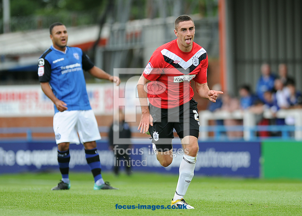 Picture by Chris Donnelly/Focus Images Ltd. 07500 903009 .13/8/11..Lee Novak of Huddersfield celebrates the first goal during the Npower match at Spotland Stadium, Rochdale, Greater Manchester.